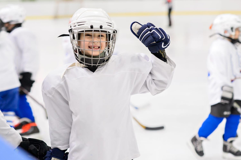 Hockey kid smiling to the camera.